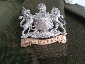 Wilfred's First Manchester Regiment insignia